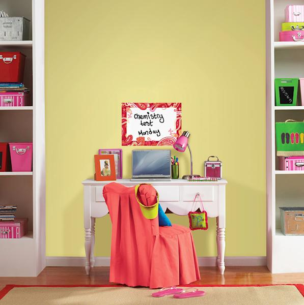 This publicity photo provided by courtesy of Brewster Home Fashions shows the WallPops Paisley Please Red Dry-Erase Message Board that can help keep a student's desk area organized. (AP Photo/Brewster Home Fashions)