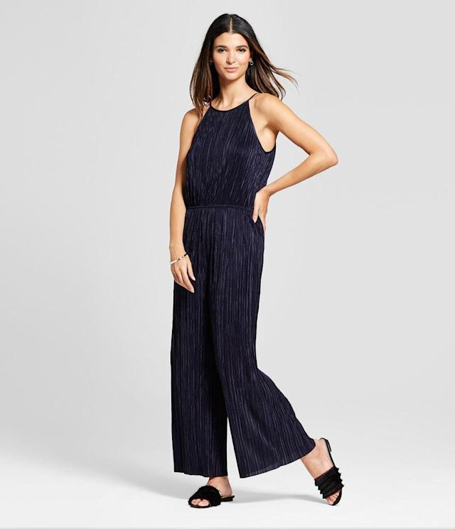 "<p>Women's Pleated Jumpsuit in Eclair Navy, $50, <a href=""https://www.target.com/p/women-s-pleated-jumpsuit-201-clair-navy/-/A-53295463?preselect=53239524"" rel=""nofollow noopener"" target=""_blank"" data-ylk=""slk:target.com"" class=""link rapid-noclick-resp"">target.com</a> </p>"