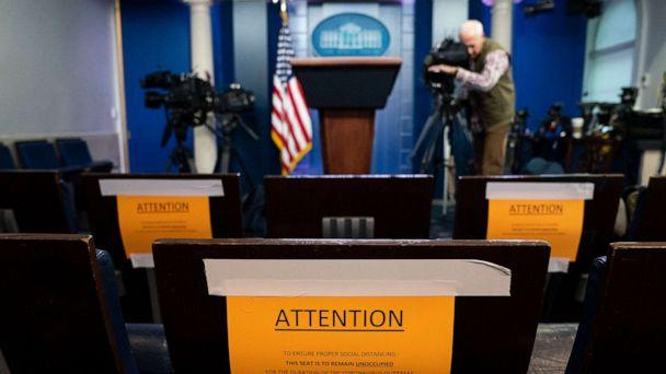 PHOTO: Signs in the briefing room of the White House indicate social distancing measures being taken to separate reporters working at the White House, March 16, 2020, in Washington. (Evan Vucci/AP)