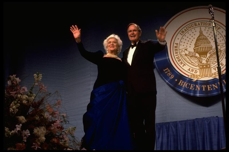 Pres. George and Barbara Bush onstage at inaugural ball greeting wellwishers.