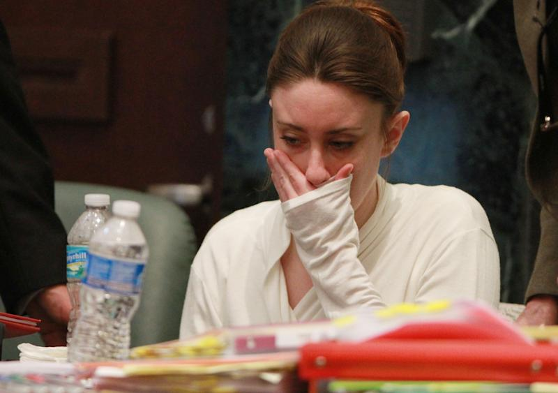 Casey Anthony is seen during a break in her murder trial at the Orange County Courthouse on Thursday, June 9, 2011, in Orlando, Fla.  Anthony, accused of killing her 2-year-old daughter in 2008, took ill Thursday, prompting the judge in her murder trial to recess court early and end the most intense day of evidence so far, which included jurors and Anthony viewing pictures of the toddler's decomposed skull. (AP Photo/Joe Burbank, Pool)