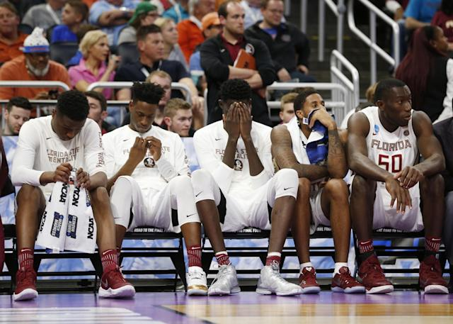 <p>Florida State players sit on the bench in the final seconds of a second-round game against Xavier in the NCAA men's college basketball tournament, Saturday, March 18, 2017, in Orlando, Fla. Xavier defeated Florida State 91-66. (AP Photo/Wilfredo Lee) </p>