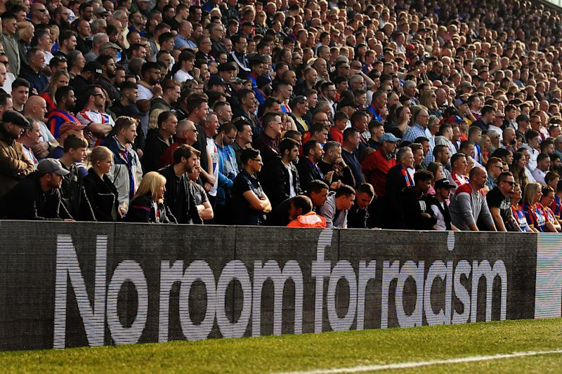 LONDON, ENGLAND - MARCH 30: Fans look on as an anti racism message is shown on the advertising boards during the Premier League match between Crystal Palace and Huddersfield Town at Selhurst Park on March 30, 2019 in London, United Kingdom. (Photo by Marc Atkins/Getty Images)