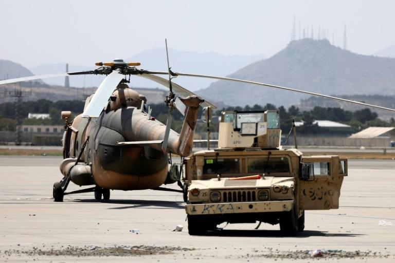 Dozens of damaged planes and vehicles were cordoned off by Taliban barricades (AFP/Karim SAHIB)