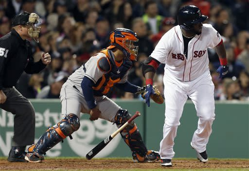Boston Red Sox's David Ortiz, right, watches his two-run double in front of Houston Astros catcher Carlos Corporan, center, in the second inning of a baseball game in Boston, Saturday, April 27, 2013. (AP Photo/Michael Dwyer)