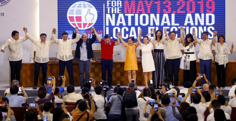 Twelve newly-proclaimed senators raise their hands during a ceremony at the Commission on Elections in suburban Pasay city south of Manila, Philippines Wednesday, May 22, 2019. They are, from left, Senators Bong Revilla, Francis Tolentino, Lito Lapid, Ronald Dela Rosa, Christopher Go, Cynthia Villar, Grace Poe, Pia Cayetano, Sonny Angara, Imee Marcos, Aquilino Pimentel and Nancy Binay. (AP Photo/Bullit Marquez)
