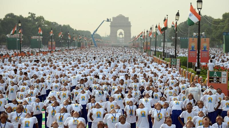 People take part in a mass yoga session to mark International Yoga Day on Rajpath in New Delhi on June 21, 2015 (AFP Photo/Prakash Singh)