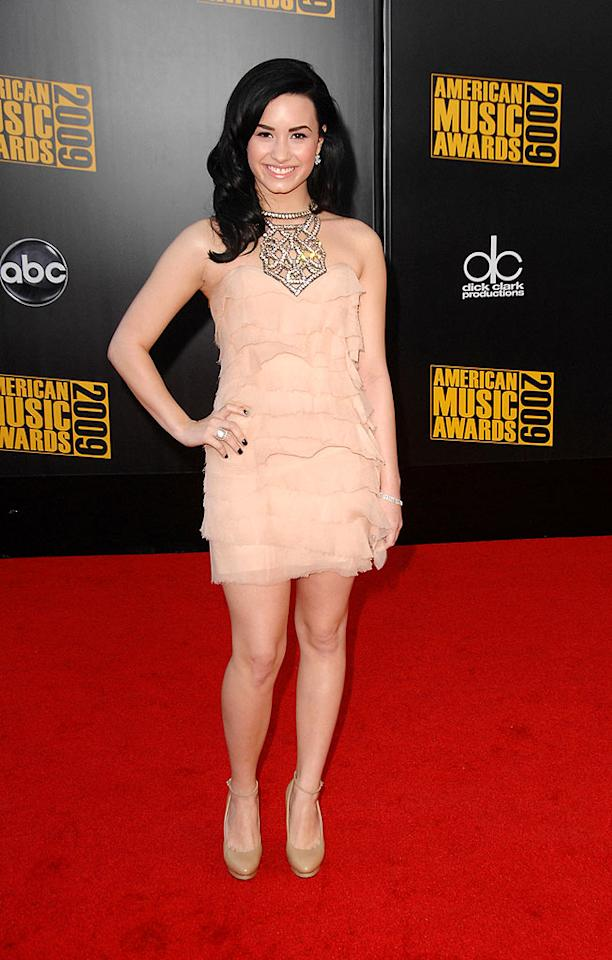 "Demi Lovato  Grade: B  It is us, or did the ""Sonny With a Chance"" star's blinged-out, ruffled blush mini and nude pumps make her look much older than her 17 years of age? Steve Granitz/<a href=""http://www.wireimage.com"" target=""new"">WireImage.com</a> - November 22, 2009"