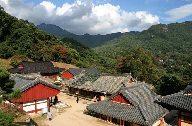 <p><strong>Where: </strong>Mount Gaya, South Korea</p>  <p>Tucked into the mountains of South Korea, the 15th-century, UNESCO-designated houses the <em>Tripitaka Koreana</em>, the most extensive collection of Buddhist texts in the world. Its Janggyeong Panjeon buildings additionally store over 80,000 woodblocks, used to print books before the invention of the printing press.</p>  <p><strong>Insider Tip:</strong> Though the <em>Tripitaka Koreana</em> collection is not open to the public, you can still visit the temple complex and peek inside.</p>  <p><strong>Plan Your Trip: </strong>Visit .</p>