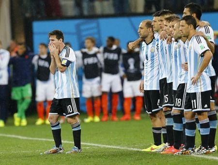 Argentina's Lionel Messi reacts next to teammates during a penalty shootout in their 2014 World Cup semi-finals against Netherlands at the Corinthians arena in Sao Paulo July 9, 2014. REUTERS/Darren Staples