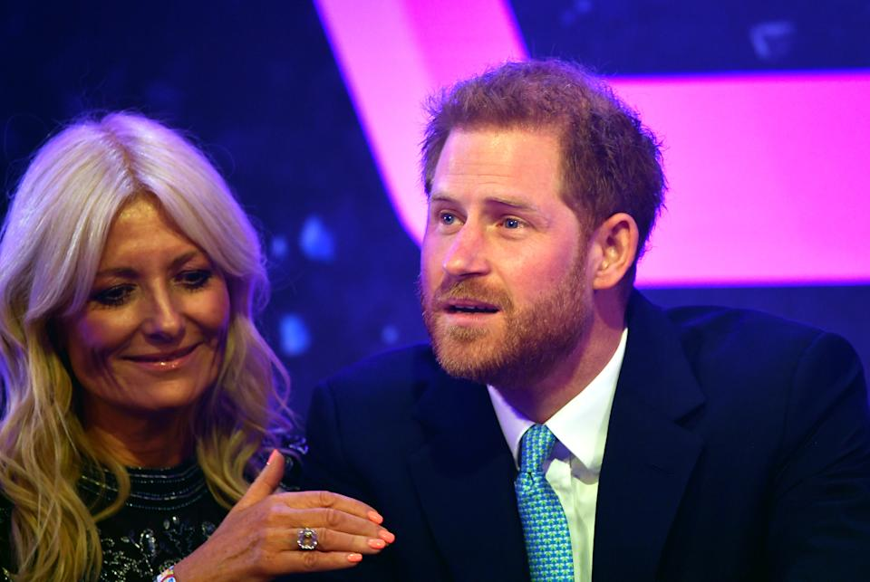 Britain's Prince Harry reacts next to television presenter Gaby Roslin as he delivers a speech during the WellChild Awards Ceremony reception in London, Britain, October 15, 2019. REUTERS/Toby Melville/Pool