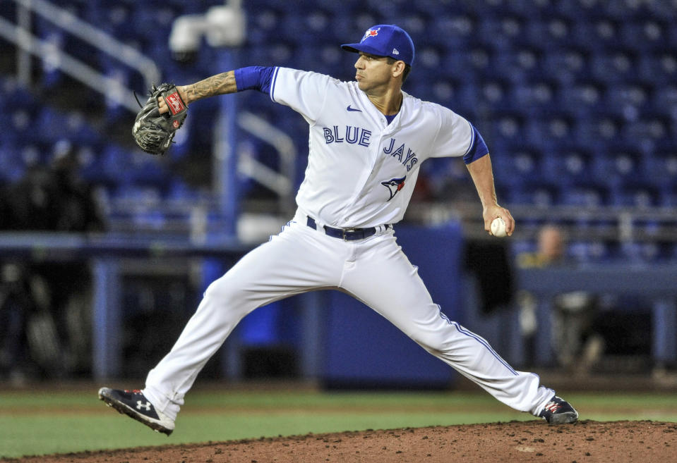 Toronto Blue Jays reliever Tommy Milone throws to a Los Angeles Angels batter during the ninth inning of a baseball game Saturday, April 10, 2021, in Dunedin, Fla. The Blue Jays won 15-1. (AP Photo/Steve Nesius)