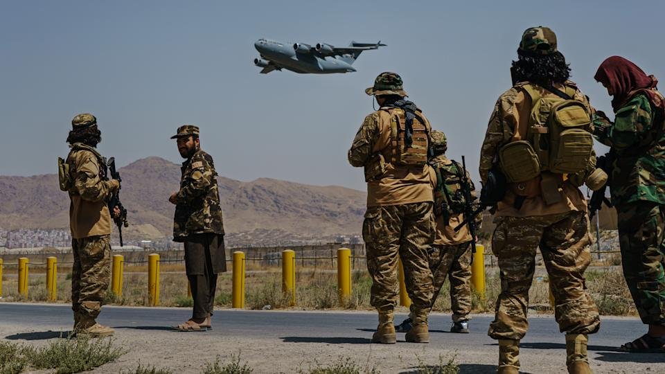 A C-17 Globemaster takes off as Taliban fighters secure the outer perimeter, alongside the American controlled side of of the Hamid Karzai International Airport in Kabul, Afghanistan, Sunday, Aug. 29, 2021. (Marcus Yam/ Los Angeles Times via Getty Images)