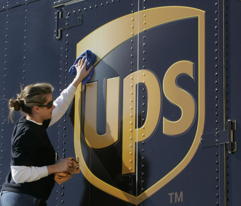 FILE - In a Jan. 25, 2007 file photo Brandy Goggin polishes a UPS sign on a UPS truck in New Orleans.  United Parcel Service Inc. said Monday March 19, 2012, it has agreed to buy TNT Express NV for $6.77 billion (€5.16 billion).  (AP Photo/Bill Haber/file)