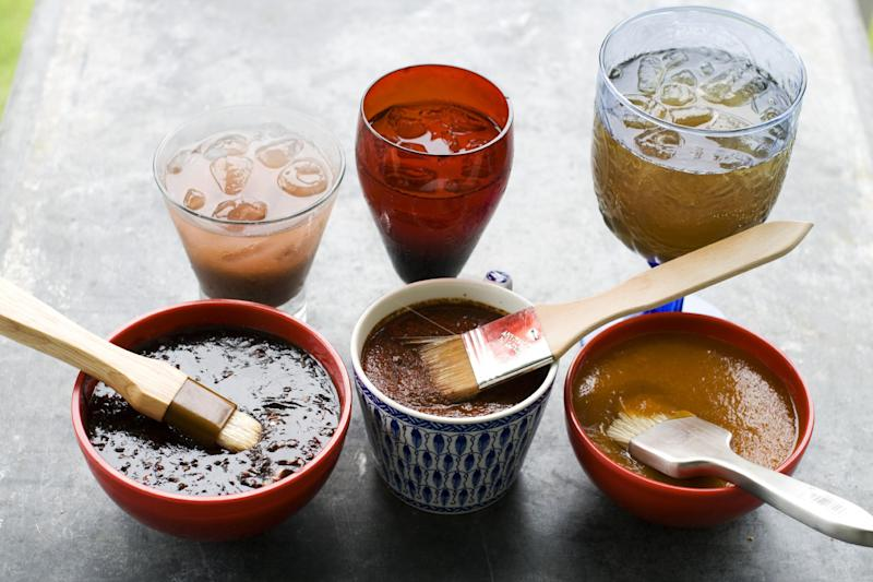 In this image taken on June 10, 2013, from left, balsamic strawberry jalapeno barbecue sauce, recado rojo, and tangy apricot barbecue sauce, are shown with cocktails in Concord, N.H. (AP Photo/Matthew Mead)