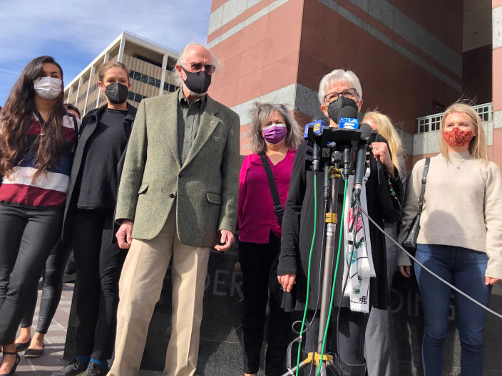 Kathleen McIlvain, center, speaks outside federal court in Los Angeles on Feb. 16, 2021, after the court appearance of Jerry Boylan, a scuba dive boat captain who is charged with 34 counts of seaman's manslaughter. McIlvain's son, Charles McIlvain, was among 34 people killed during a 2019 fire aboard Boylan's boat. (AP Photo/Stefanie Dazio)