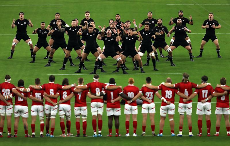 OITA, JAPAN - OCTOBER 02: New Zealand players perform the Haka prior to the Rugby World Cup 2019 Group B game between New Zealand and Canada at Oita Stadium on October 02, 2019 in Oita, Japan. (Photo by Shaun Botterill/Getty Images)