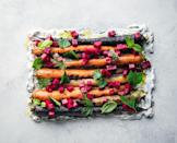"""If you're still firing up the grill come Thanksgiving, consider this dish of charred carrots set atop a creamy cooling yogurt sauce and dressed with pickled beets. <a href=""""https://www.epicurious.com/recipes/food/views/grilled-carrots-with-herby-coconut-yogurt-and-spicy-beet-vinaigrette-gregory-gourdet-everyones-table?mbid=synd_yahoo_rss"""" rel=""""nofollow noopener"""" target=""""_blank"""" data-ylk=""""slk:See recipe."""" class=""""link rapid-noclick-resp"""">See recipe.</a>"""