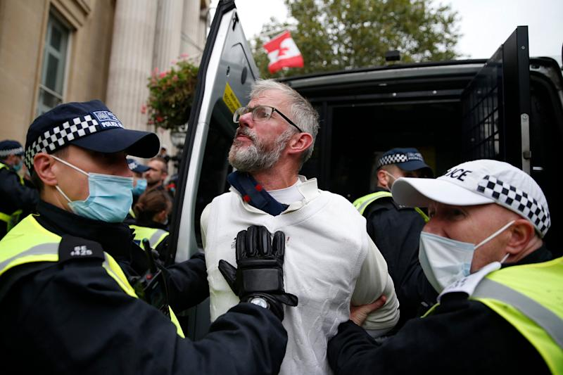 Police arrest a protester (Getty Images)