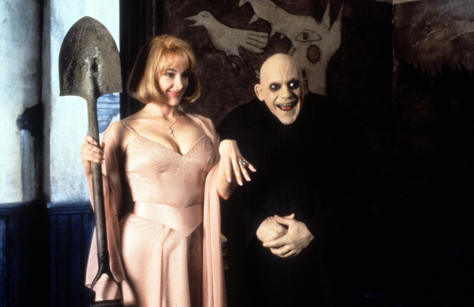 Joan Cusack holding shovel next to a smiling Christopher Lloyd in a scene from the film 'Addams Family Values', 1993. (Photo by Paramount/Getty Images)