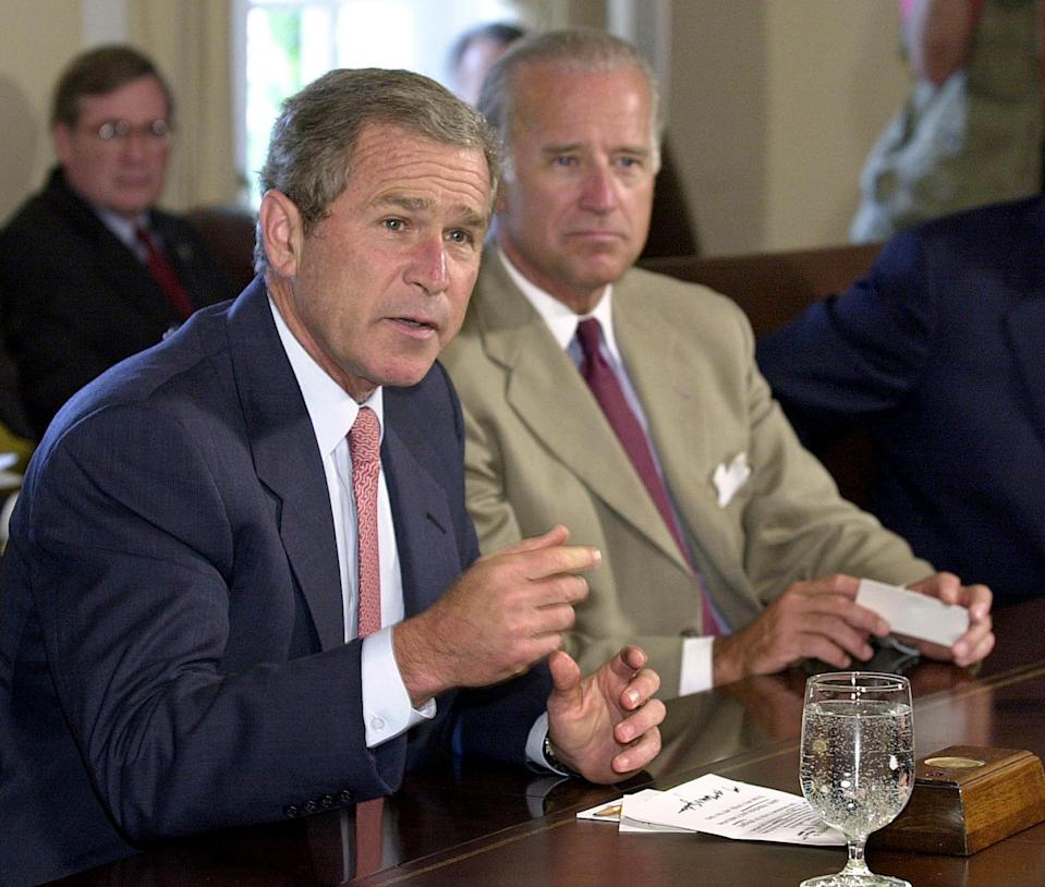 Bush and Biden during a meeting on July 25, 2001 at the White House. (Mike Theiler / AFP via Getty Images)