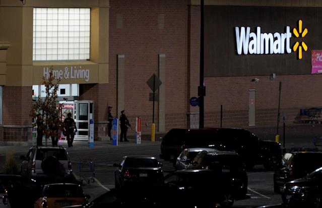 <p>Police guard the entrance at the scene of a shooting at a Walmart in Thornton, Colo., Nov. 1, 2017. (Photo: Rick Wilking/Reuters) </p>