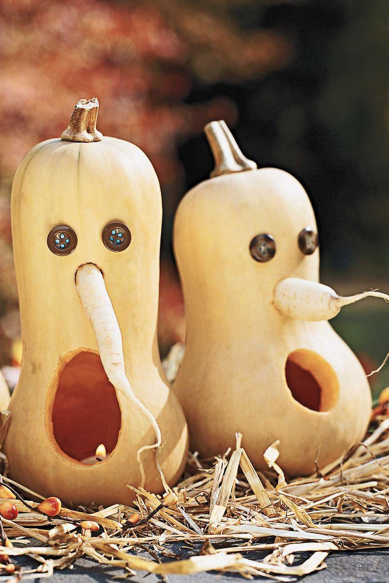 <p>Who says a Jack-o'-Lantern has to be made from a pumpkin? These butternut squash goblins sport button eyes and parsnip noses; carving out the vegetable from the bottom adds stability and makes adding a light easy. </p>