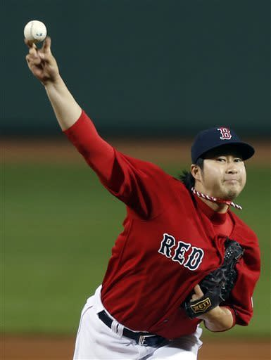 Boston Red Sox's Junichi Tazawa pitches in the seventh inning of a baseball game against the Houston Astros in Boston, Friday, April 26, 2013. (AP Photo/Michael Dwyer)