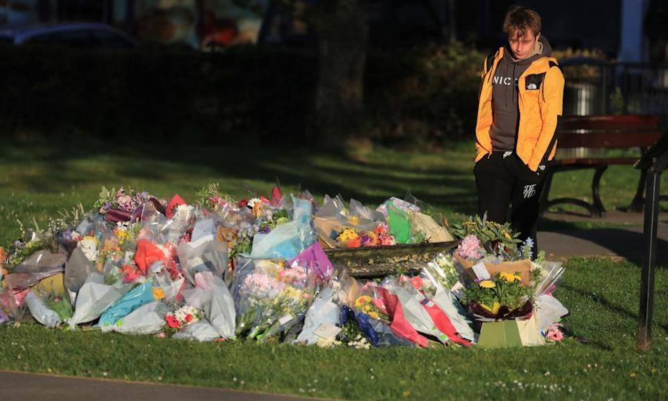Patrick James, the son of PCSO Julia James, looks at floral tributes left near her family home in Snowdown, near Aylesham, east Kent.