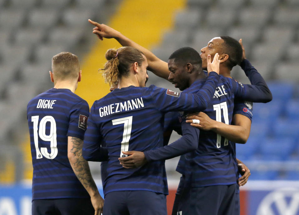 France players celebrate after France's Ousmane Dembele, second right, scored his side's opening goal during the World Cup 2022 group D qualifying soccer match between Kazakhstan and France at the Astana Arena stadium in Nur-Sultan, Kazakhstan, Sunday, March 28, 2021. (AP Photo/Stanislav Filippov)
