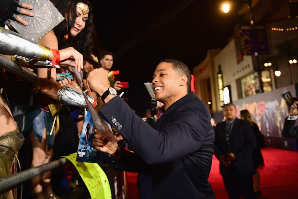 Ray Fisher signs autographs at the premiere of