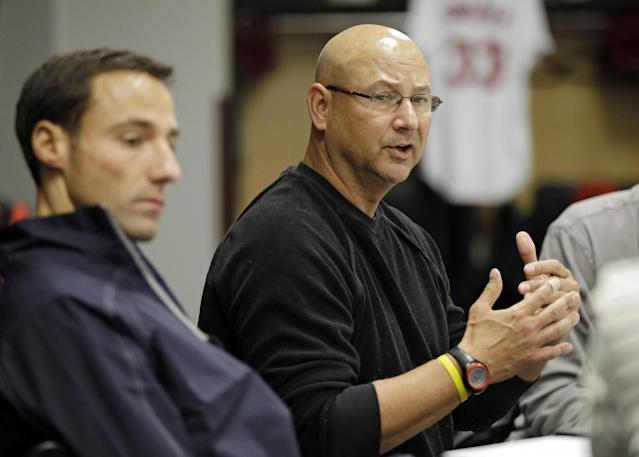 Cleveland Indians manager Terry Francona, right, talks about the 2013 season with general manager Chris Antonetti, left, in Cleveland, Monday, Oct. 7, 2013. The Indians lost to the Tampa Bay Rays in the AL wild-card last Wednesday, ending their season. (AP Photo/Mark Duncan)
