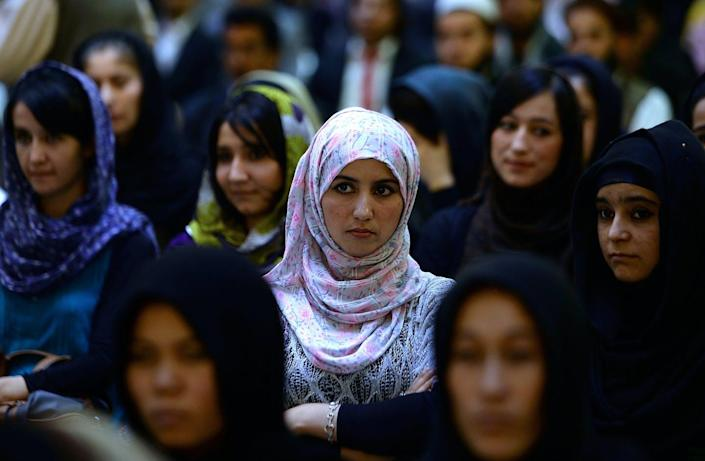 """<span class=""""caption"""">Audience members listen to Afghan parliamentarian Fawzia Koofi speak in 2014. Women's access to politics increased greatly after the Taliban's 2001 ouster.</span> <span class=""""attribution""""><a class=""""link rapid-noclick-resp"""" href=""""https://www.gettyimages.com/detail/news-photo/afghan-women-listen-to-a-speaker-address-a-political-news-photo/181903098"""" rel=""""nofollow noopener"""" target=""""_blank"""" data-ylk=""""slk:Sha Marai/AFP via Getty Images"""">Sha Marai/AFP via Getty Images</a></span>"""