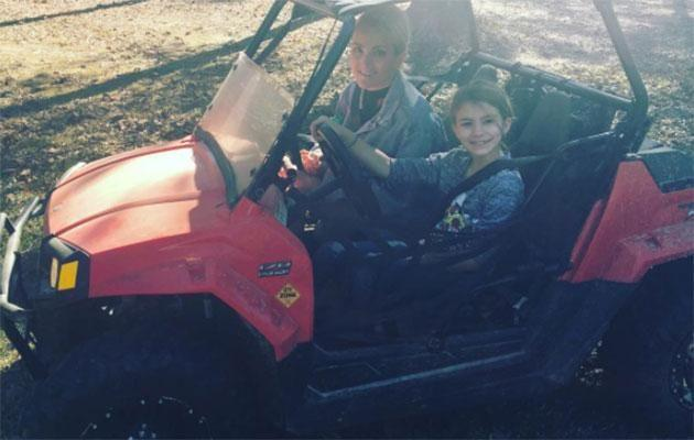 Maddie, pictured in a ATV on a separate occasion, was airlifted to hospital after the accident. Source: Instagram