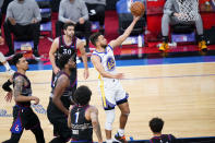 Golden State Warriors' Stephen Curry, right, goes for a shot during the first half of an NBA basketball game against the Philadelphia 76ers, Monday, April 19, 2021, in Philadelphia. (AP Photo/Matt Slocum)