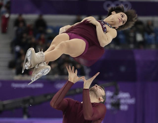 Meagan Duhamel and Eric Radford of Canada perform in the pairs free skate figure skating final in the Gangneung Ice Arena at the 2018 Winter Olympics in Gangneung, South Korea, Thursday, Feb. 15, 2018. (AP Photo/Julie Jacobson)