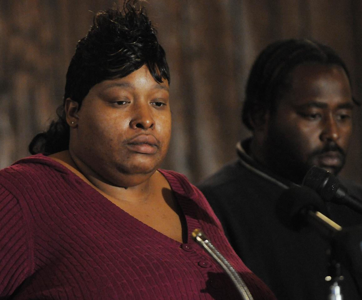 Julia Hudson, sister of actress Jennifer Hudson, left, and Greg King plead for the safe return of their son Julian King who was abducted from the Hudson family home where the sisters' mother and brother were found dead in Chicago, Saturday Oct. 25, 2008. Julia Husdon was speaking to members of the media at the Pleasant Gift Missionary Baptist Church in Chicago (AP Photo/David Banks)