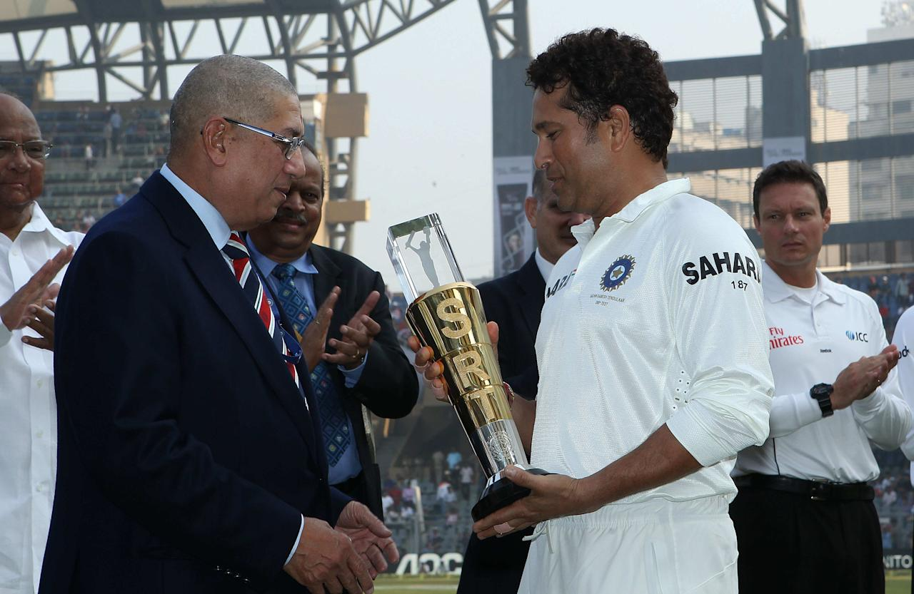 N Srinivasan presents Sachin Tendulkar of India with a trophy to commemorate his 200th test during day one of the second Star Sports test match between India and The West Indies held at The Wankhede Stadium in Mumbai, India on the 14th November 2013  This test match is the 200th test match for Sachin Tendulkar and his last for India.  After a career spanning more than 24yrs Sachin is retiring from cricket and this test match is his last appearance on the field of play.   Photo by: Ron Gaunt - BCCI - SPORTZPICS  Use of this image is subject to the terms and conditions as outlined by the BCCI. These terms can be found by following this link:  https://ec.yimg.com/ec?url=http%3a%2f%2fsportzpics.photoshelter.com%2fgallery%2fBCCI-Image-Terms%2fG0000ahUVIIEBQ84%2fC0000whs75.ajndY&t=1502963069&sig=J6MPbJxIBrjykjKN8gyUYQ--~D