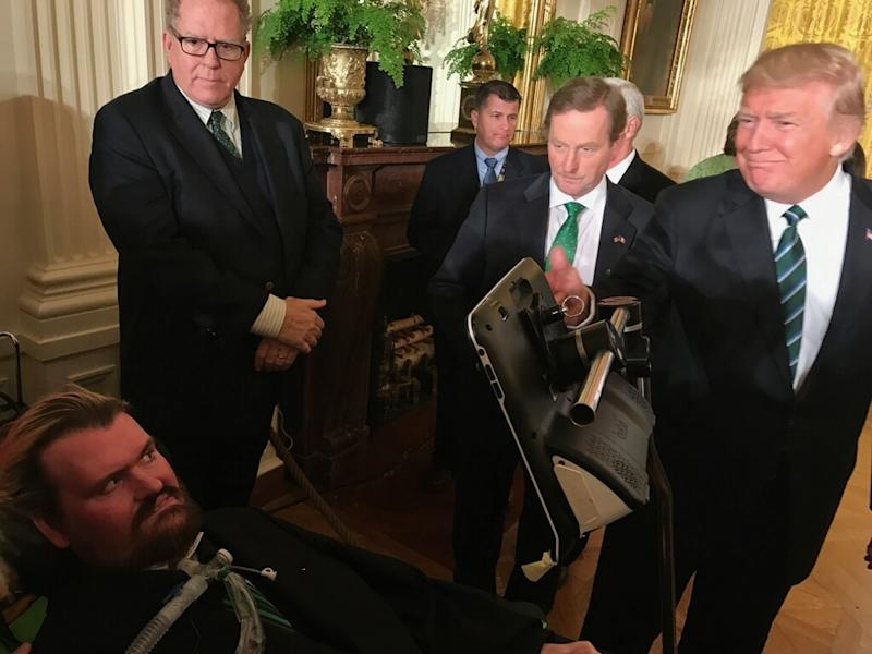 """In this photo provided by Sayreville Mayor Kennedy O'Brien, President Donald Trump, right, greets Patrick Sean O'Brien, who suffers from amyotrophic laterals sclerosis, or ALS, at the White House on Thursday, March 16, 2017, in Washington. Sayreville Mayor Kennedy O'Brien says the White House """"moved heaven and earth"""" to get his 42-year-old son to Thursday night's dinner with Trump and Irish Prime Minister Enda Kenny. (Kennedy O'Brien via AP)"""