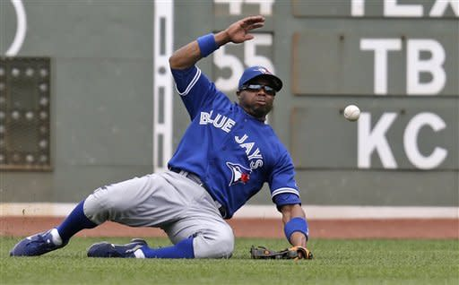 Toronto Blue Jays left fielder Rajai Davis can't make the play on a double by Boston Red Sox' Mike Aviles during the fourth inning of a baseball game at Fenway Park in Boston, Wednesday, June 27, 2012. (AP Photo/Charles Krupa)