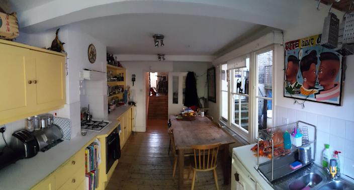 "<div class=""caption""> The kitchen before lacked light and space. </div>"