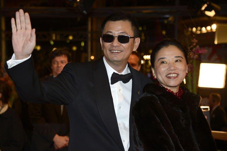 Chinese director Wong Kar Wai (L) and his wife, Esther, at the Berlinale film festival in Berlin on February 7, 2013