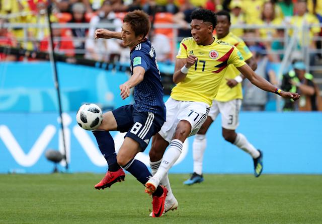 Soccer Football - World Cup - Group H - Colombia vs Japan - Mordovia Arena, Saransk, Russia - June 19, 2018 Colombia's Johan Mojica in action with Japan's Genki Haraguchi REUTERS/Ricardo Moraes