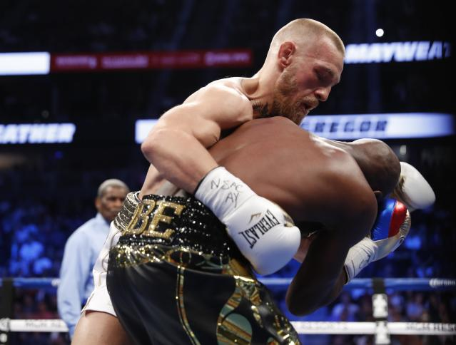 <p>Conor McGregor in action with Floyd Mayweather Jr., Saturday, Aug. 26, 2017, in Las Vegas. REUTERS/Steve Marcus </p>