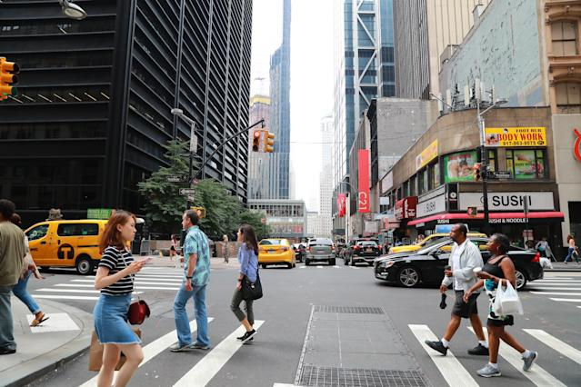 <p>Pedestrians walk across Broadway at the intersection of Cortlandt Street just down the street from the World Trade Center site on Aug. 12, 2017. (Photo: Gordon Donovan/Yahoo News) </p>