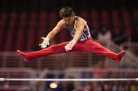 Yul Moldauer competes on the horizontal bar during the men's U.S. Olympic Gymnastics Trials Thursday, June 24, 2021, in St. Louis. (AP Photo/Jeff Roberson)