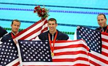 <p>Michael Phelps stands with teammates Brendan Hansen and Jason Lezak of the United States after winning the gold medal in the 4 x 100-meter medley relay on August 17, 2008 in Beijing. The United States team set a new world record with a time of 3:29:34. (Adam Pretty/Getty Images)</p>