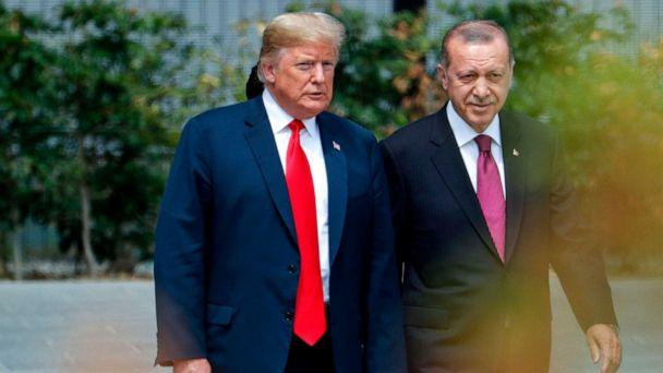 PHOTO: President Donald Trump speaks to Turkey's President Recep Tayyip Erdogan during the opening ceremony of the NATO summit at the NATO headquarters in Brussels. (Geoffroy Van Der Hasselt/AFP/Getty Images, FILE)