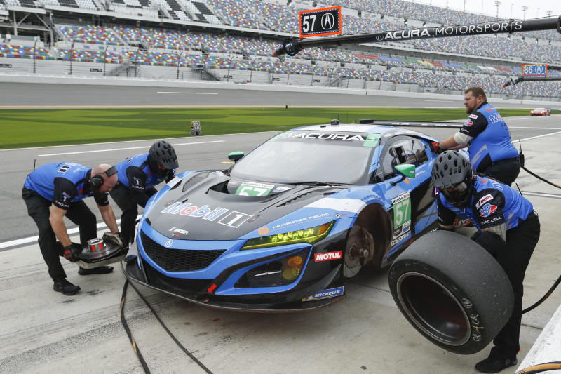 The car in the pits during practice for the Rolex 24 hour auto race at the Daytona International Speedway, in Daytona Beach Fla., on Thursday, Jan. 23, 2020. (AP Photo/Reinhold Matay)