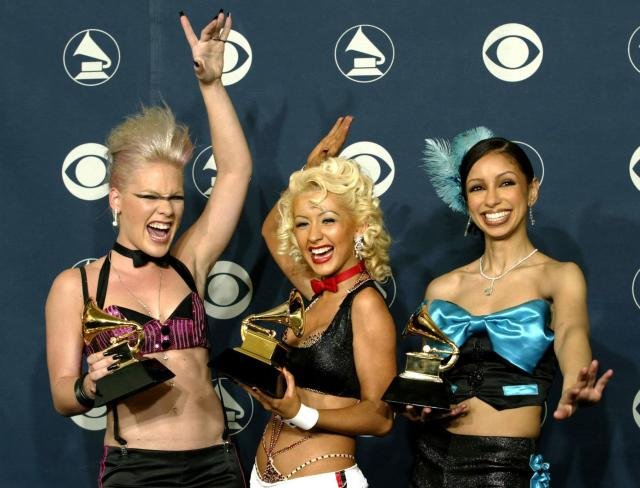 """Pink, Christina Aguilera and Mya pose with the Grammy Award they won for """"Lady Marmalade"""" on Feb. 27, 2002."""